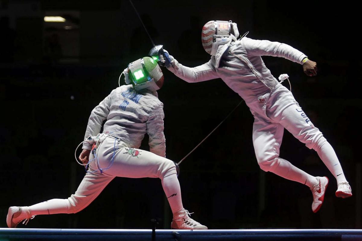 Mojtaba Abedini (left) of Iran in action against Daryl Homer of the USA in the men's sabre individual semi-finals of the Rio 2016 Olympic Games in Rio de Janeiro, Brazil, on Aug 10, 2016.