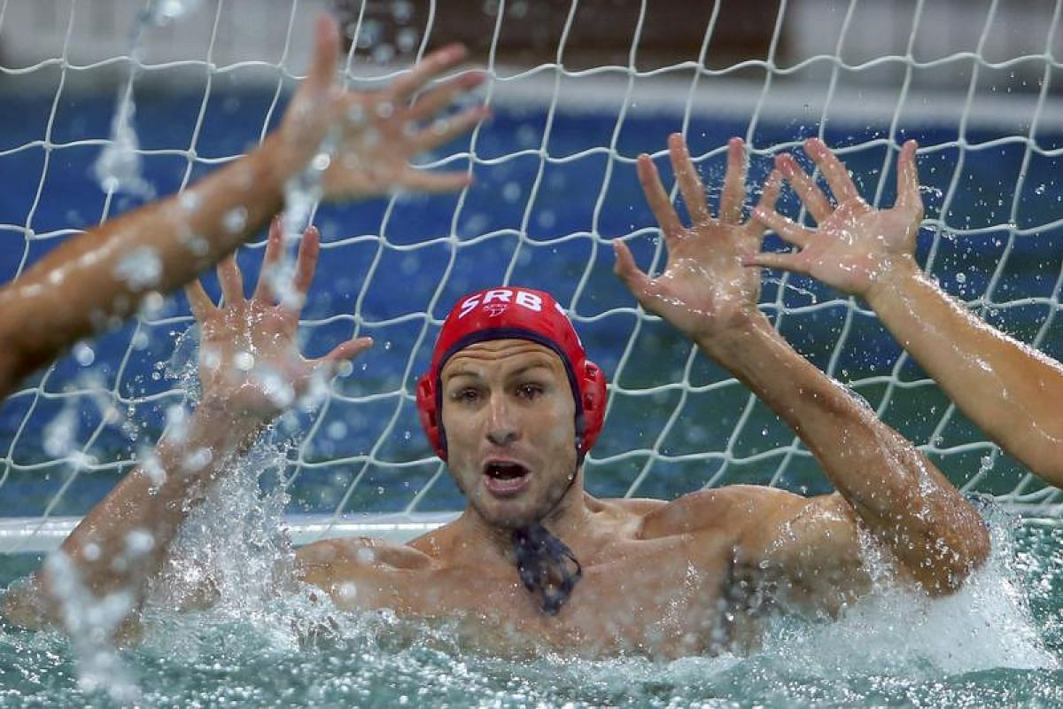 Goalkeeper Branislav Mitrovic of Serbia in action during the water polo men's preliminary round on Aug 10.