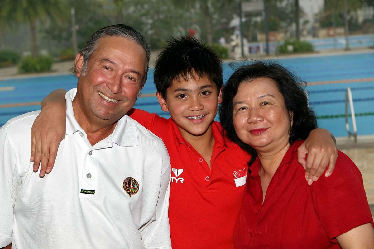 Joseph Schooling poses with his parents May and Colin Schooling in 2009.