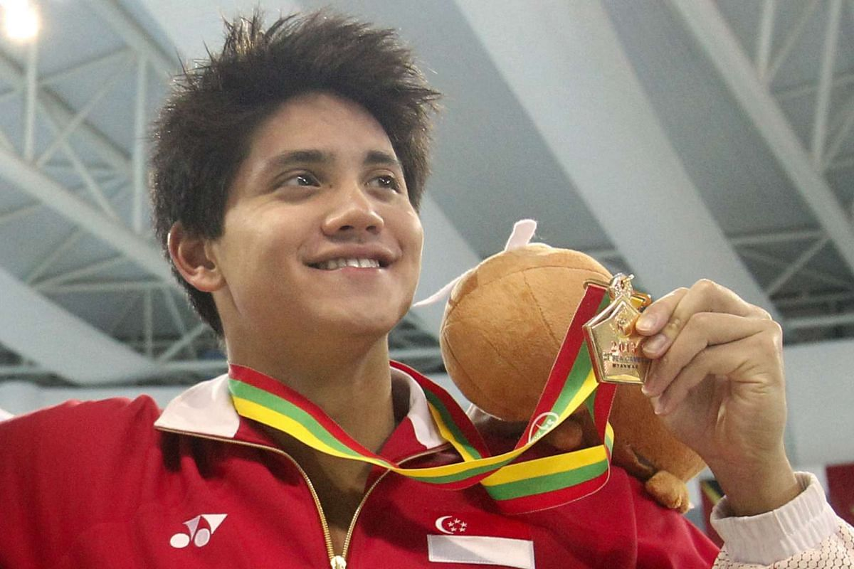 Singapore's Joseph Schooling with his gold medal from the men's 200m butterfly event in swimming competition of the 27th SEA Games in Naypyidaw's Wunna Theikdi Swimming Complex, Myanmar on Dec 16, 2013.