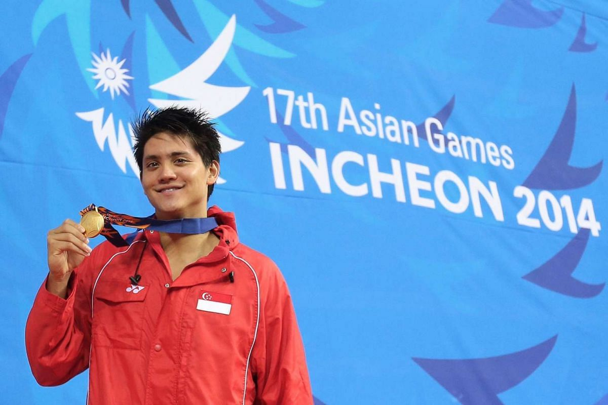 Swimmer Joseph Schooling wins Singapore's first gold in the 17th Asian Games Incheon 2014 Men's 100m butterfly event held at the Munhak Park Tae-Hwan Aquatics Center in Incheon, South Korea, on Sept 24, 2014.