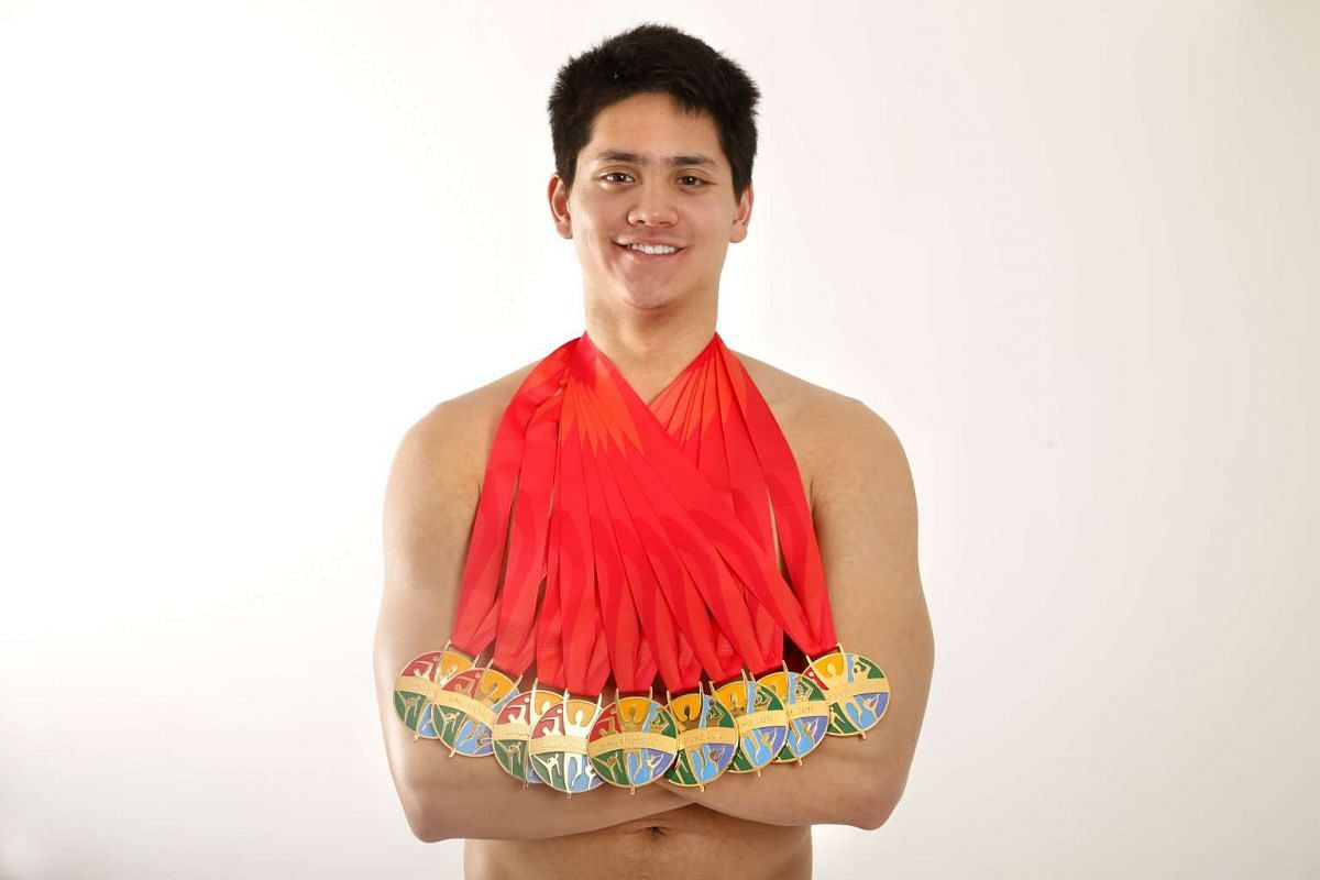 National swimmer Joseph Schooling with the nine gold medals he won at the 28th SEA Games.