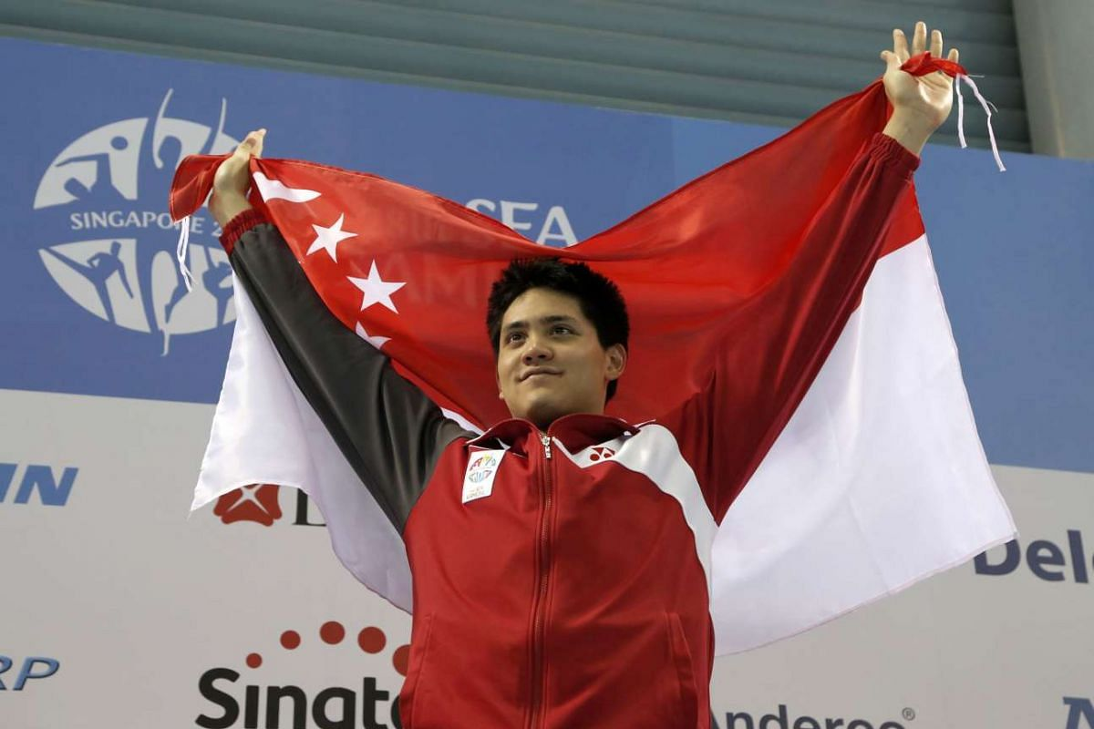 Joseph Schooling celebrates winning the gold medal in the Men's 50m Freestyle event at the 28th SEA Games.