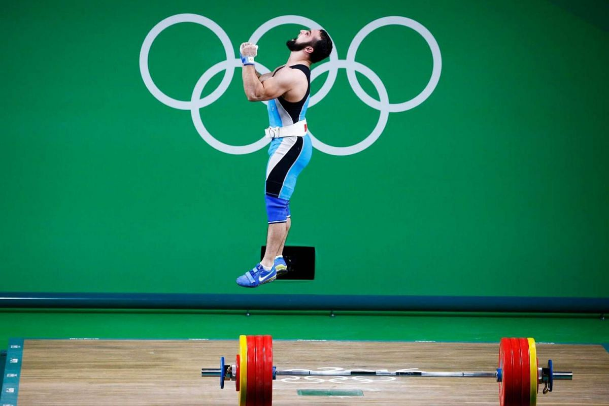 Nijat Rahimov of Kazakhstan celebrates after an attempt in men's 77kg category final of the Rio 2016 Olympic Games Weightlifting events at the Riocentro on Aug 10.