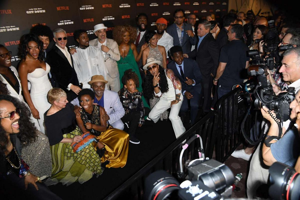 The cast and crew of The Get Down pose for the cameras at the premiere.