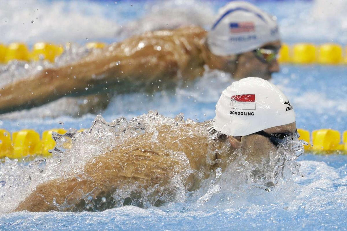 Joseph Schooling of Singapore leading Michael Phelps of the USA during the Rio 2016 Olympic Games men's 100m butterfly heats at the Olympic Aquatics Stadium in Rio de Janeiro on Aug 11, 2016.
