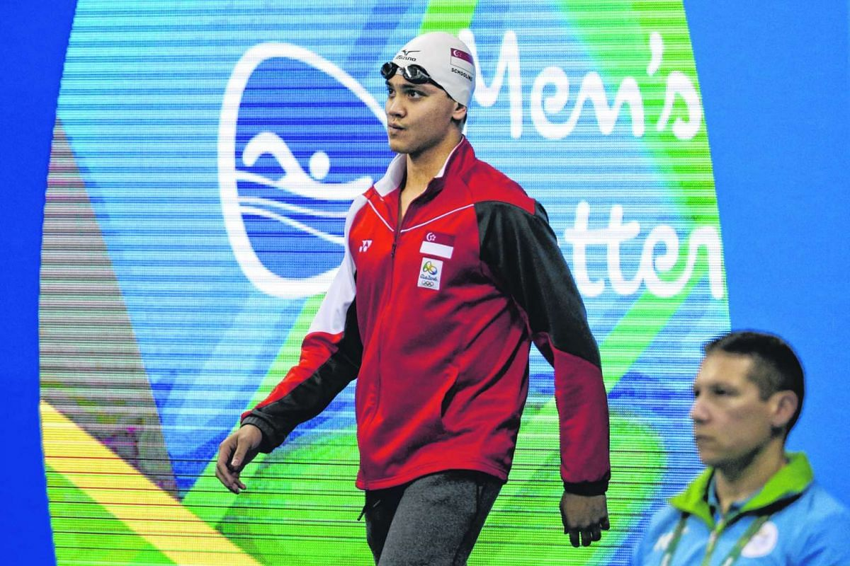 Joseph Schooling of Singapore makes his entrance during the Rio 2016 Olympic Games men's 100m butterfly heats at the Olympic Aquatics Stadium in Rio de Janeiro on Aug 11, 2016.