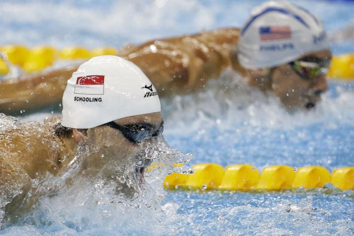 Joseph Schooling of Singapore leading Michael Phelps of the USA during the Rio 2016 Olympic Games men's 100m butterfly heats at the Olympic Aquatics Stadium in Rio de Janeiro, Brazil, on Aug 11, 2016.