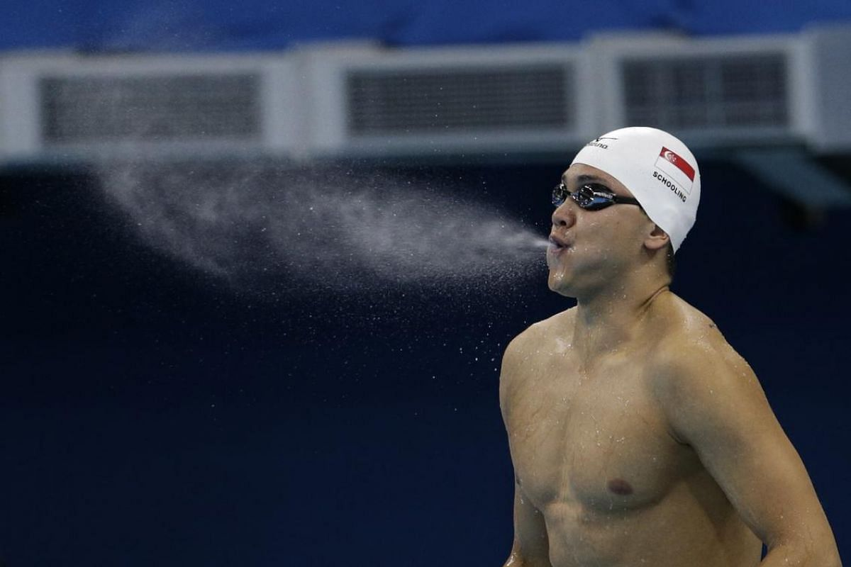 Joseph Schooling spews water out of his mouth during the Rio 2016 Olympic Games men's 100m butterfly heats at the Olympic Aquatics Stadium in Rio de Janeiro, Brazil, on Aug 11, 2016.