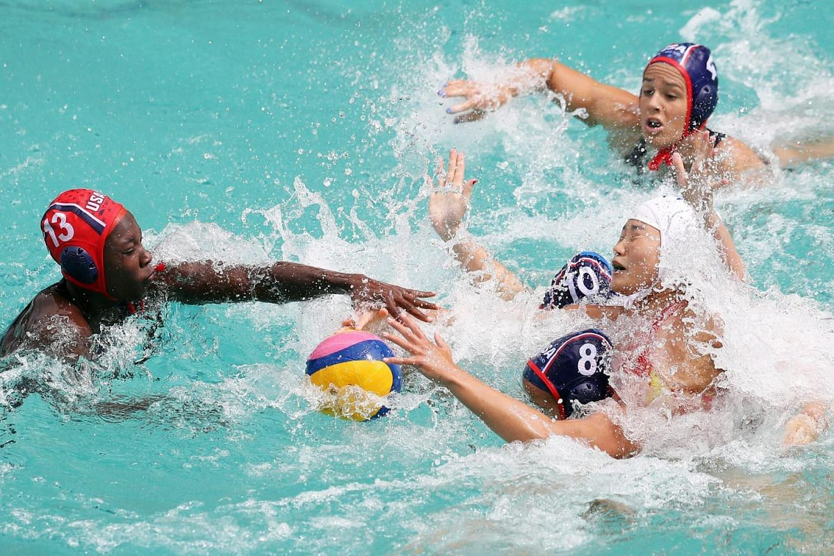 Goalkeeper Ashleigh Johnson (left) tries to grab the ball during the women's preliminary round game between China and USA of the Rio 2016 Olympic Games at the Maria Lenk Aquatics Centre in the Olympic Park in Rio de Janeiro, Brazil, on Aug 11.