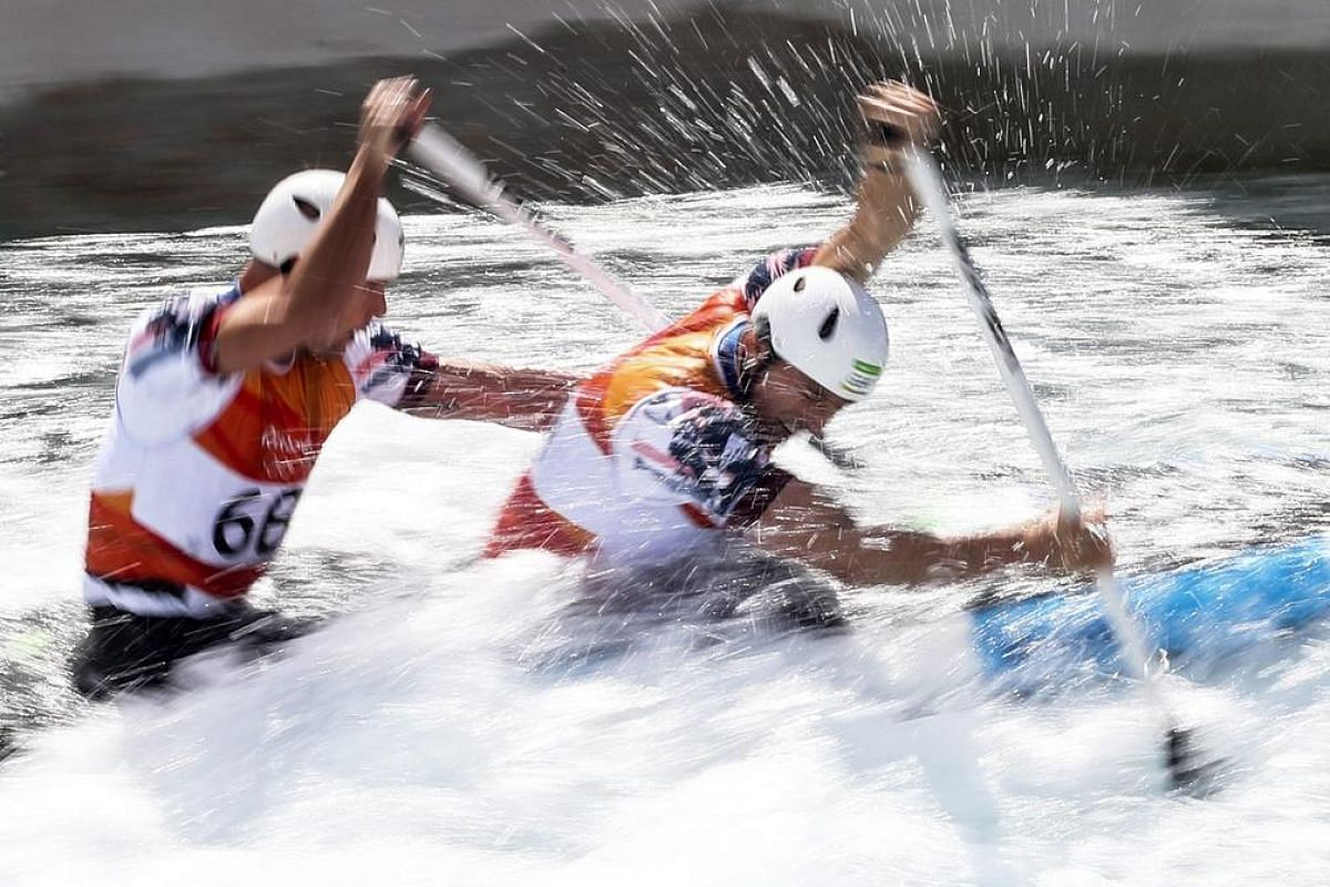 Richard Hounslow (left) and David Florence (right) of Great Britain react after the men's canoe double final race of the Rio 2016 Olympic Games canoe slalom events at the Whitewater Stadium in Rio de Janeiro, Brazil, on Aug 11.