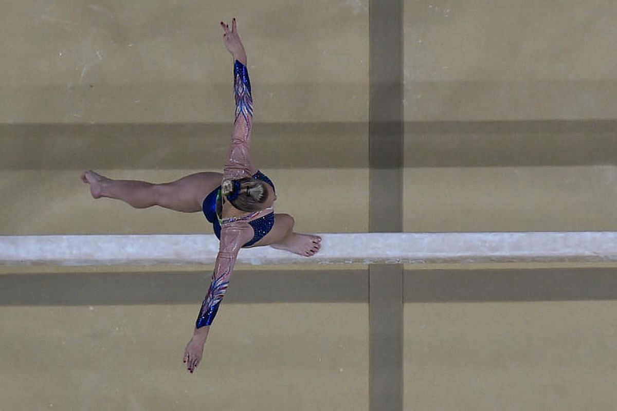 France's Marine Brevet competes in the beam event of the women's individual all-around final of the artistic gymnastics at the Olympic Arena during the Rio 2016 Olympic Games in Rio de Janeiro on Aug 11.