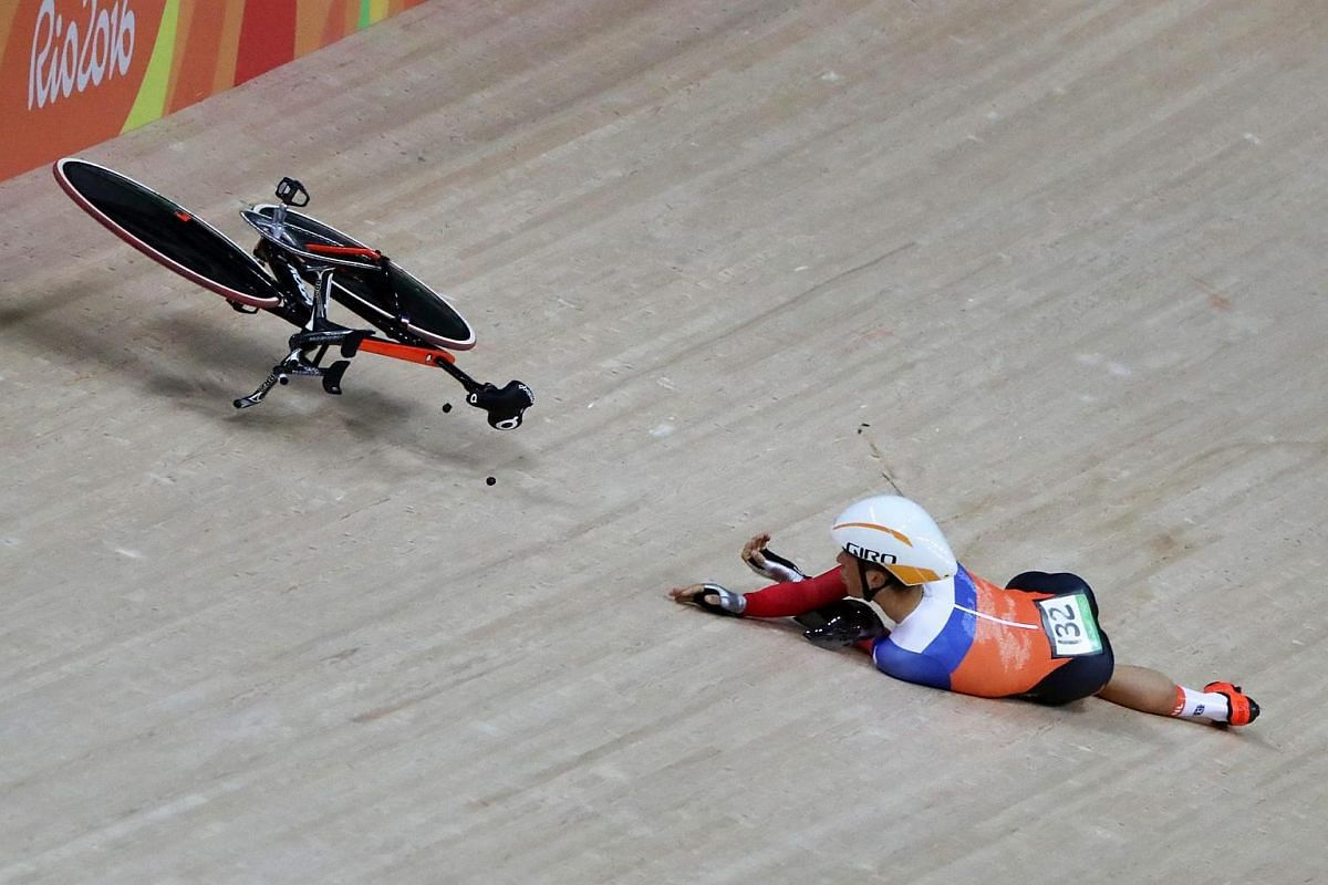Joost van den Burg of Team Netherlands crashes during the men's team pursuit qualifying competition of the Rio 2016 Olympic Games track cycling events at the Rio Olympic Velodrome in the Olympic Park in Rio de Janeiro, Brazil, on Aug 11.
