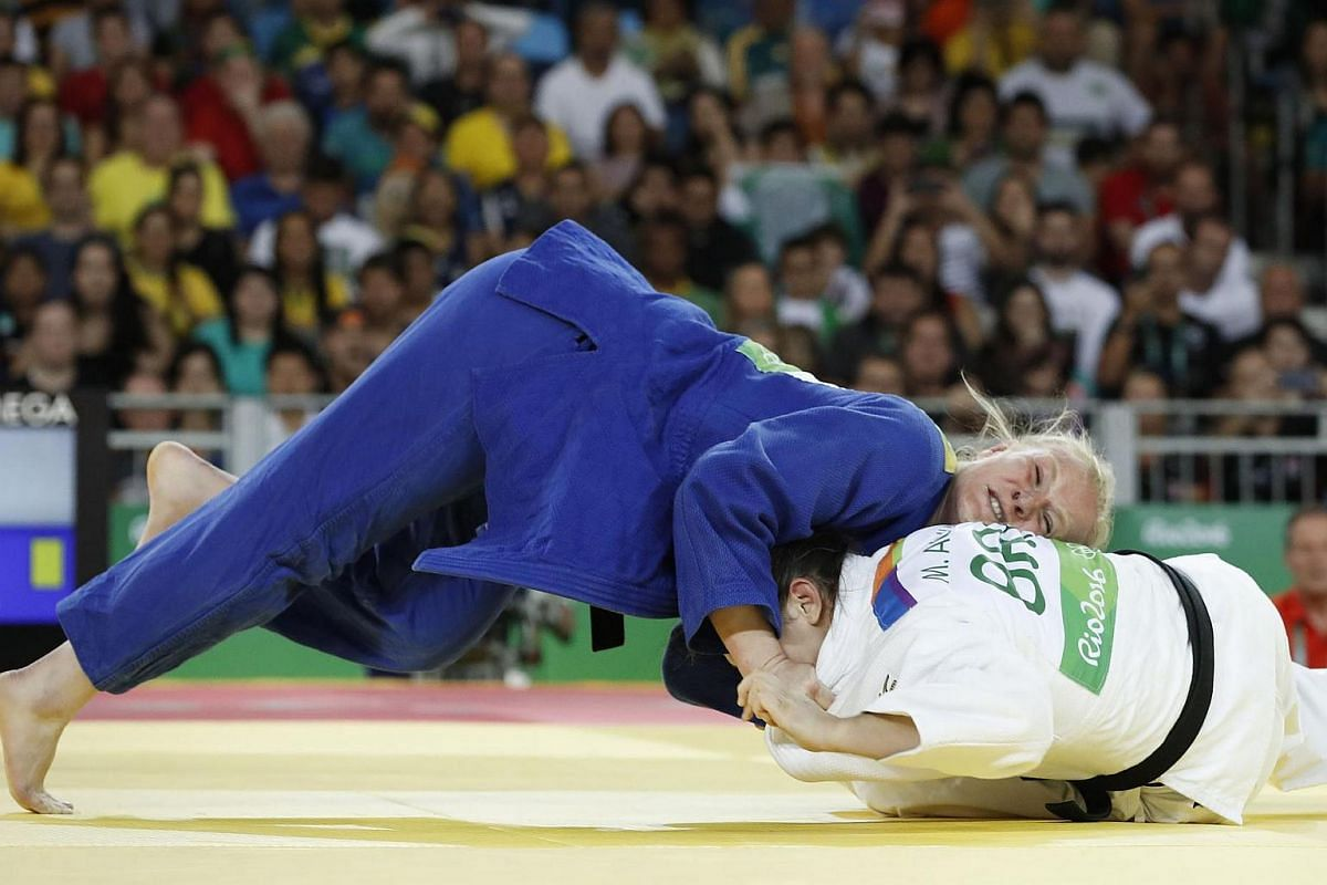 Brazil's Mayra Aguiar (white) competes with Germany's Luise Malzahn during their women's -78kg judo contest quarterfinal match of the Rio 2016 Olympic Games in Rio de Janeiro on Aug 11.