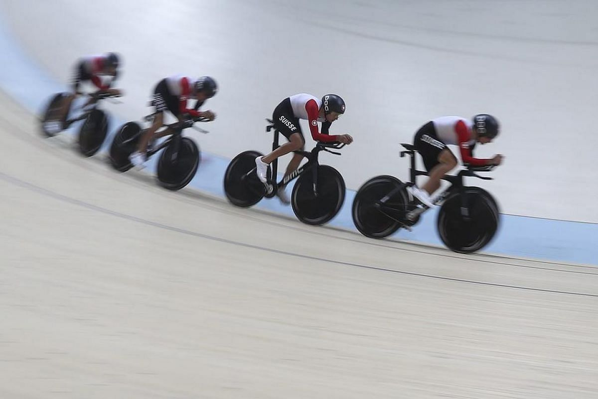 Team Switzerland competes during the men's team pursuit qualifying competition of the Rio 2016 Olympic Games track cycling events at the Rio Olympic Velodrome in the Olympic Park in Rio de Janeiro, Brazil, on Aug 11.