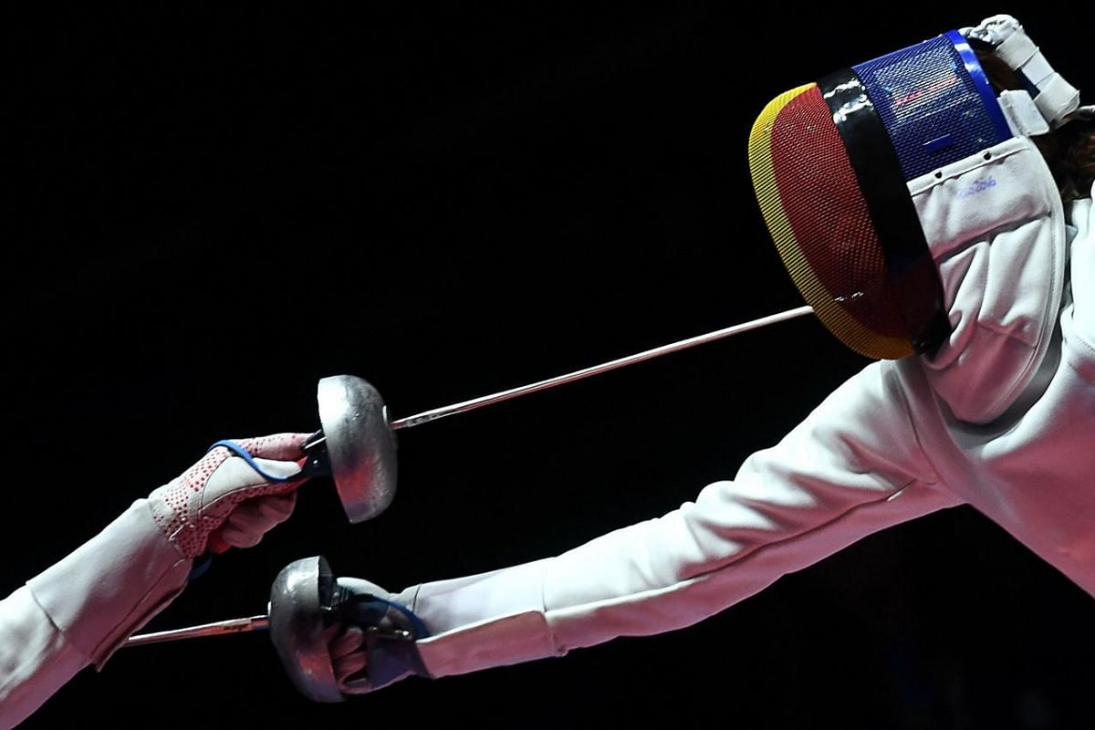 Romania's Simona Gherman (right) competes against China's Sun Yiwen during the women's team epee gold medal bout between China and Romania as part of the fencing event of the Rio 2016 Olympic Games, on Aug 11, at the Carioca Arena 3, in Rio de Jane