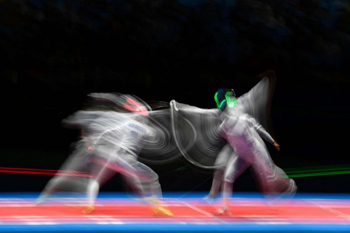 Russia's Violetta Kolobova (left) competes against Estonia's Julia Beljajeva during the women's team epee bronze medal bout between China and Romania as part of the fencing event of the Rio 2016 Olympic Games, on Aug 11, at the Carioca Arena 3, in