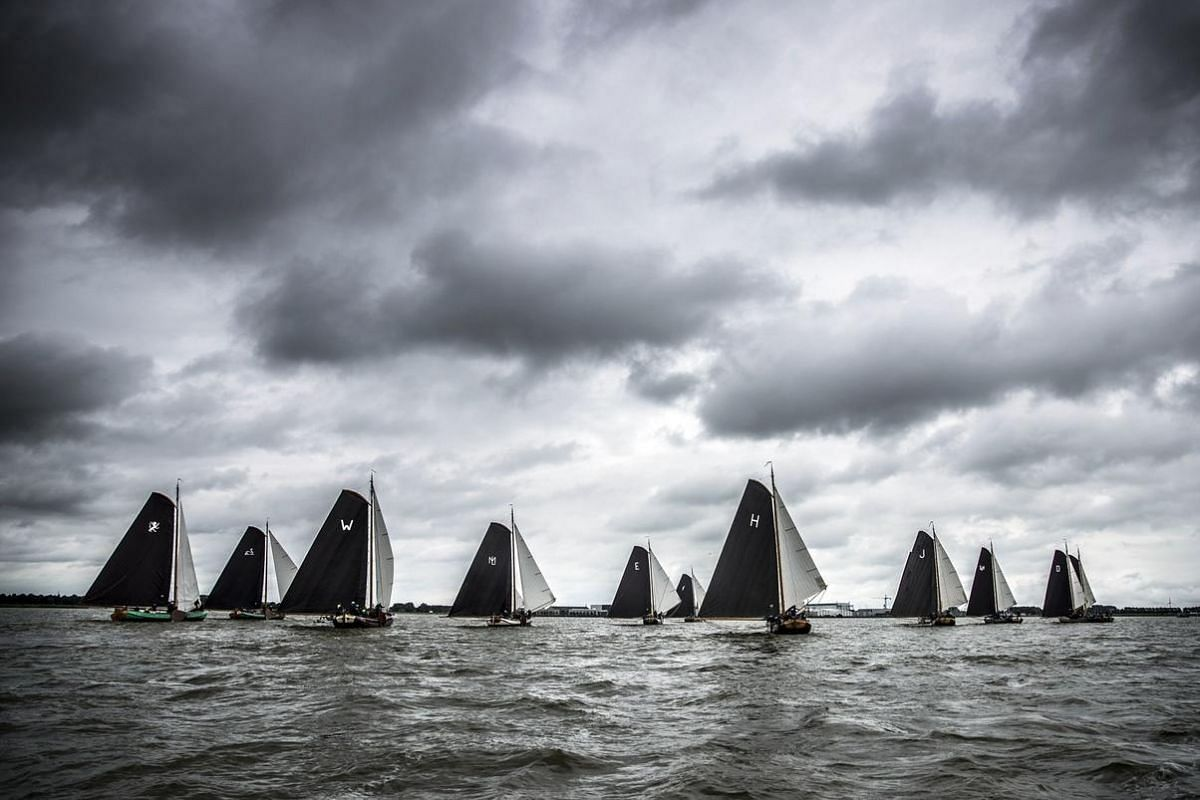 Competitors take part in the Skutsjesilen competition, a traditional boat race of sailing boats from cities in the province of Friesland, in Lemmer, on  Aug 11.