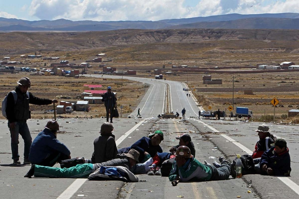 Bolivian miners block the road between La Paz and Oruro, in the sector of Mantecani, Bolivia on Aug  11.