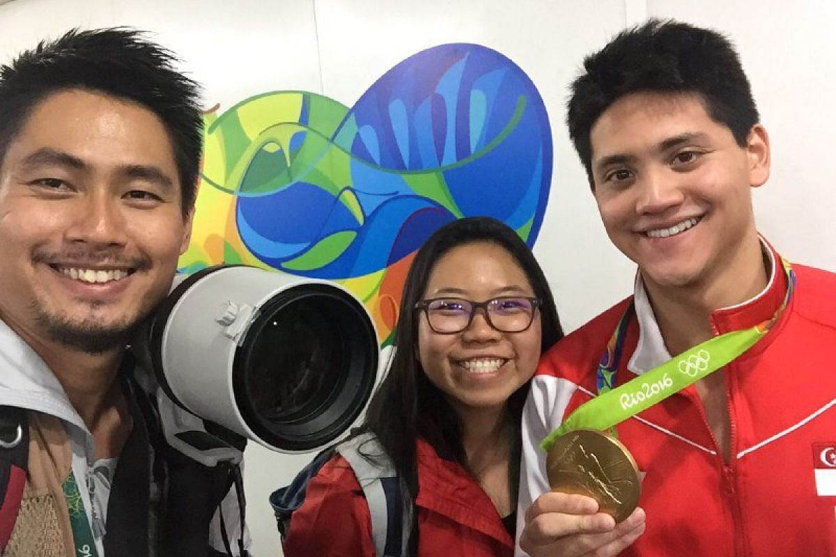 ST's photojournalist Kevin Lim (left) and sports correspondent May Chen (centre) pose with Joseph Schooling after he won a historic first Olympic gold medal for Singapore in the 100m butterfly final at the 2016 Rio Games on Aug 12 (Aug 13, Singapore