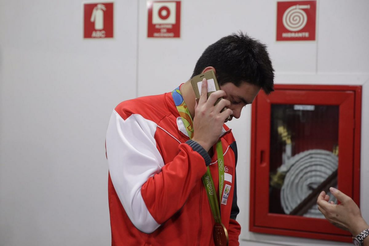Joseph Schooling on the phone with his family and friends in Singapore.
