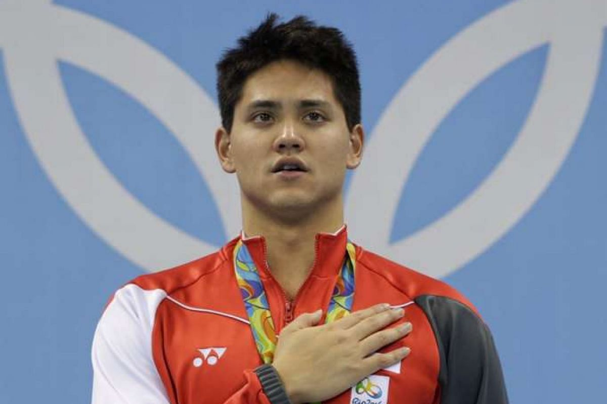 Joseph Schooling at the victory ceremony after winning gold for the men's 100m butterfly final on Aug 12.