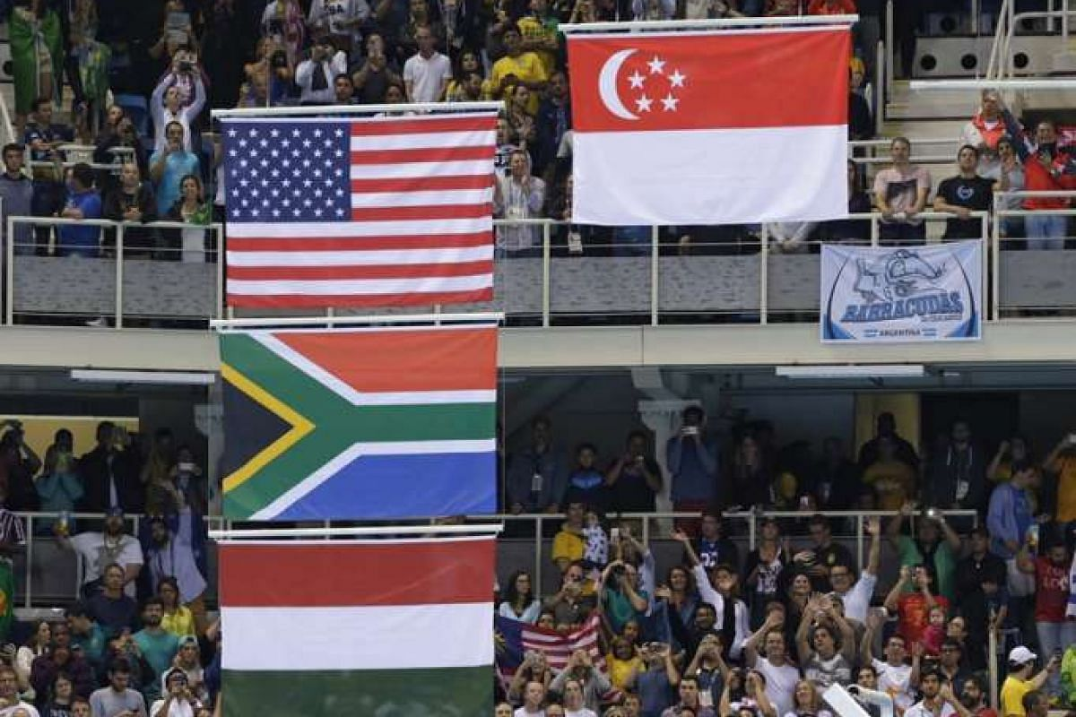 The flags of the winning countries are seen at the victory ceremony on Aug 12.