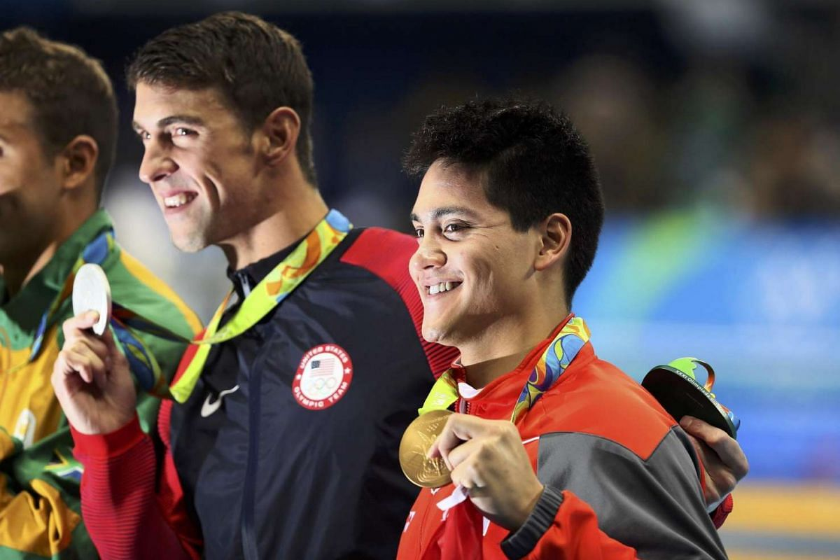 Joseph Schooling and Michael Phelps pose with their medals at the victory ceremony on Aug 12.