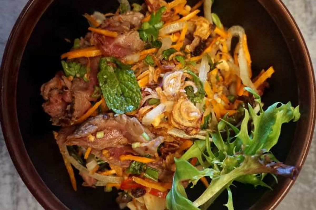 The Northern Vietnamese Beef Salad has a good amount of tender grilled beef tossed with salad greens, julienned carrot, crunchy raw onions and local celery in a spicy fish sauce dressing.