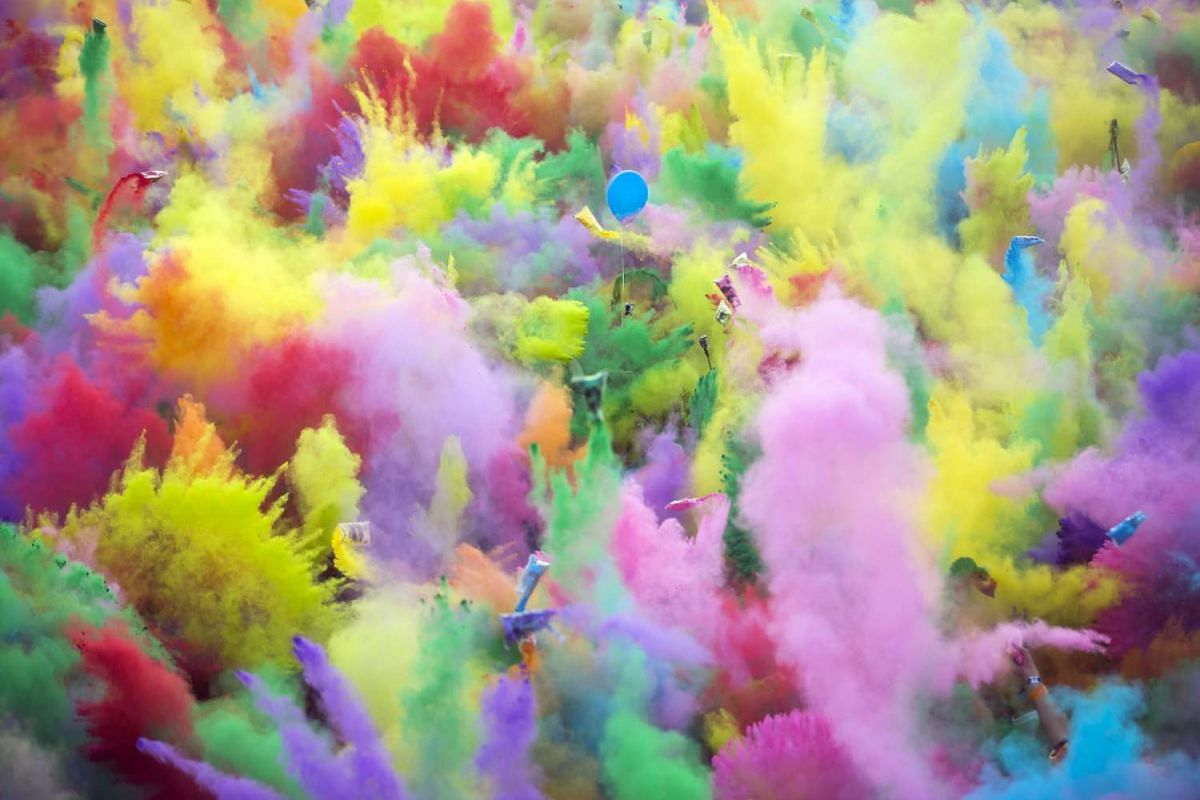 Festival goers enjoy the color party, when participants throw colored powder at each other, on the Obudai-sziget (Old Buda Island), the venue of the 24th Sziget Festival, in Northern Budapest, Hungary, August 13 2016. PHOTO: EPA