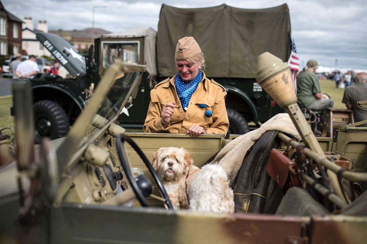 Historical reenactors take part in the 'Lytham 1940s Wartime Festival' in Lytham St Annes, north west England on August 14, 2016. PHOTO: AFP