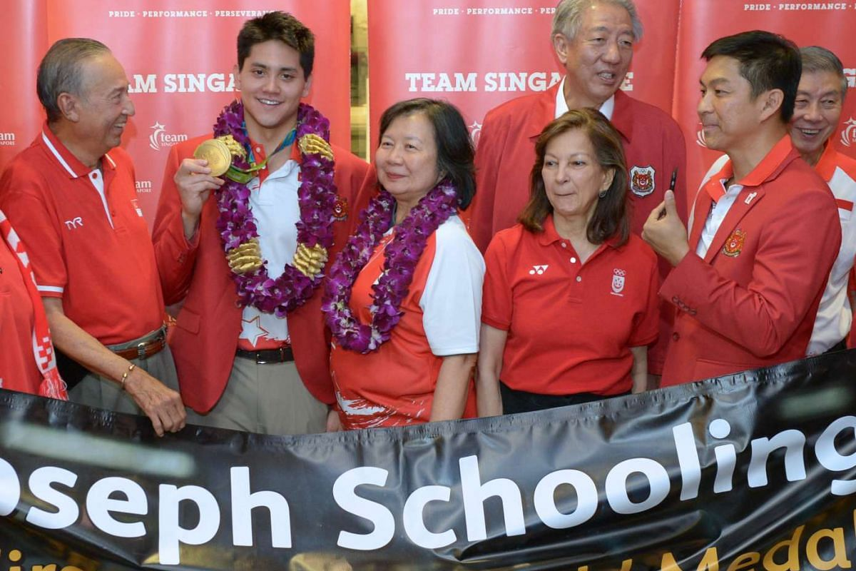From left: Mr Colin Schooling, Olympic champion Joseph Schooling, Mrs May Yim Schooling, Ms Annabel Pennefather, DPM Teo Chee Hean and Minister Tan Chuan-Jin.