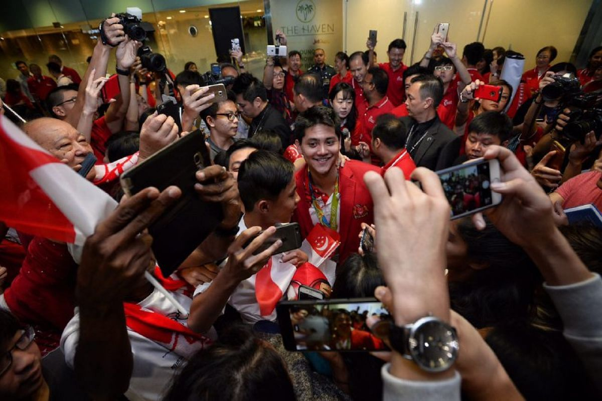 The Olympic champion surrounded by a sea of people.