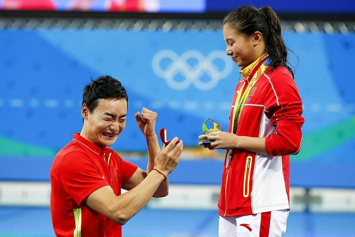 Chinese diver He Zi (right) getting a marriage proposal from compatriot Ki Qin after winning the silver medal in the women's 3m springboard final of the Rio 2016 Olympic Games Diving events on Aug 14.