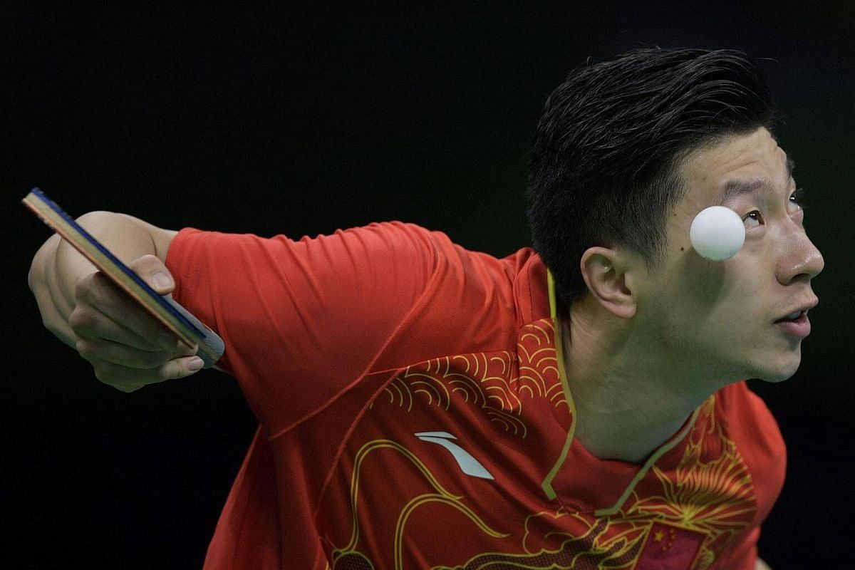 China's Ma Long eyes the ball as he serves to Britain's Liam Pitchford during the men's team quarter-final table tennis match at the Riocentro venue on Aug 14.