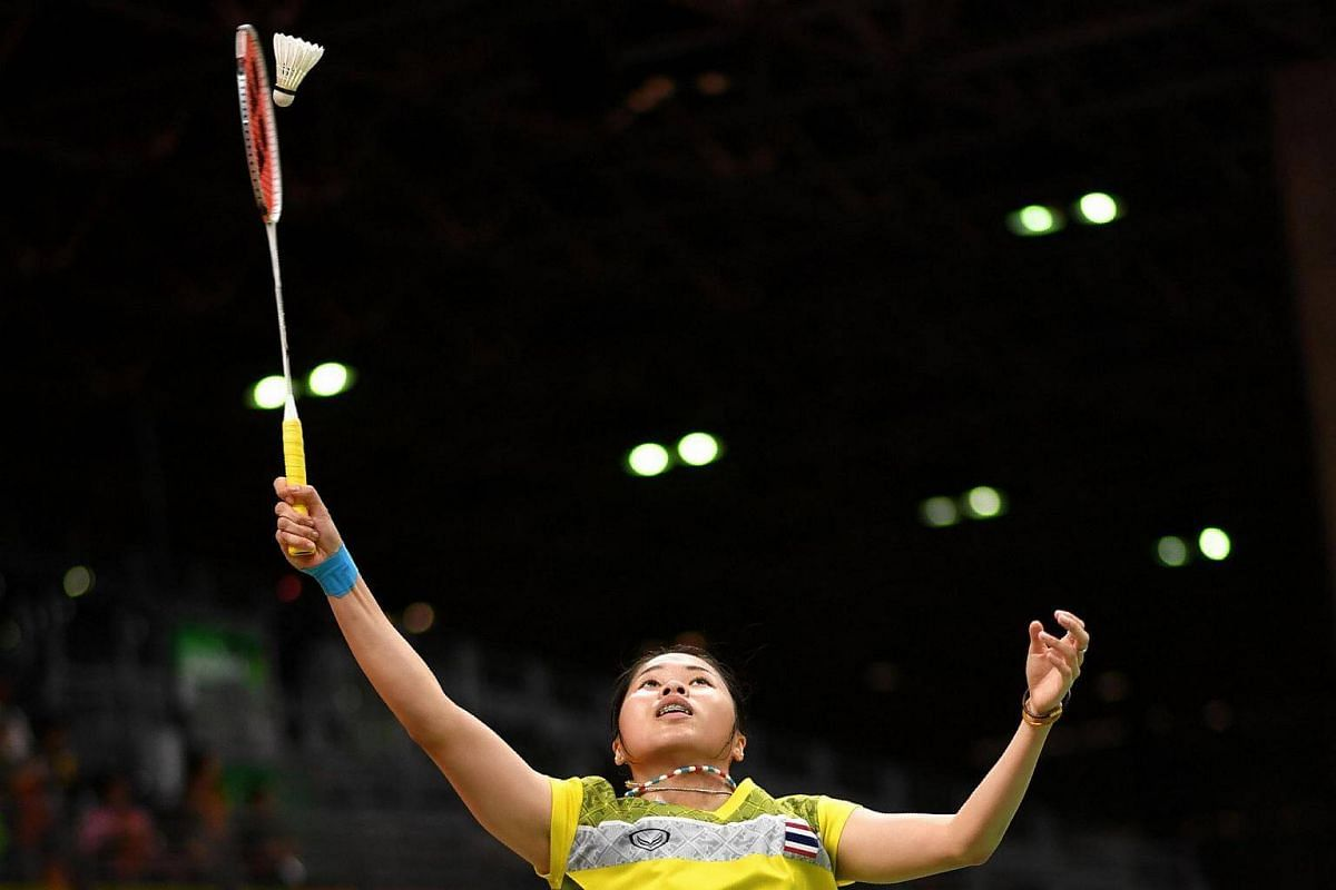 Thailand's Ratchanok Intanon returns to Hong Kong's Yip Pui Yin during their women's singles qualifying badminton match at the Riocentro stadium on Aug 14.