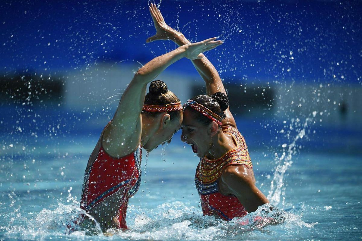 France's duet Laura Auge and Margaux Chretien compete in the duets free routine preliminaries during the synchronised swimming event at the Maria Lenk Aquatics on Aug 14.