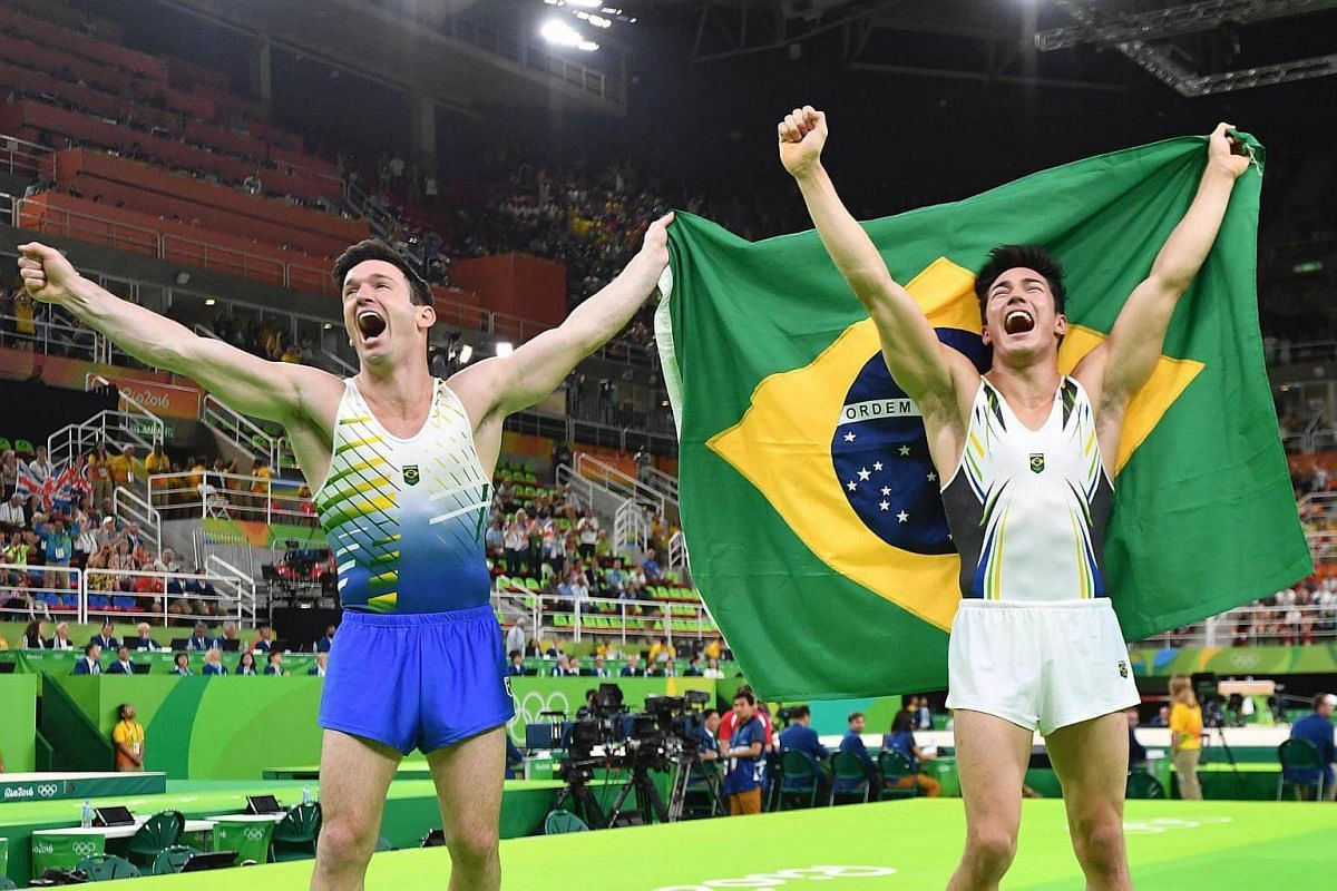 Brazil's Arthur Mariano (right) and compatriot Diego Hypolito celebrate after the men's floor event final of the artistic gymnastics events at the Olympic Arena on Aug 14.