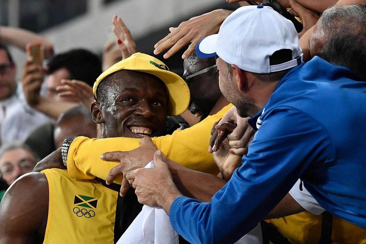 Jamaica's Usain Bolt celebrates with fans after winning the Men's 100m final at the Rio 2016 Olympic Games at the Olympic Stadium in Rio de Janeiro on Aug 14.