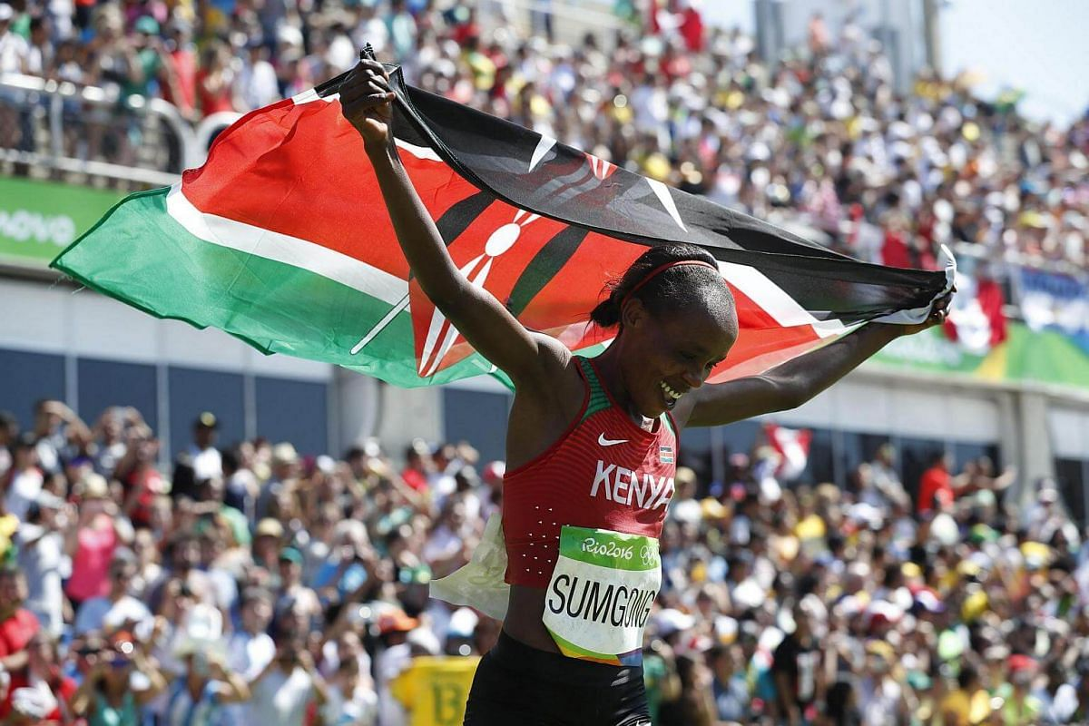 Jemima Jelagat Sumgong of Kenya celebrates after winning the women's marathon race of the Rio 2016 Olympic Games Athletics, Track and Field events on Aug 14.