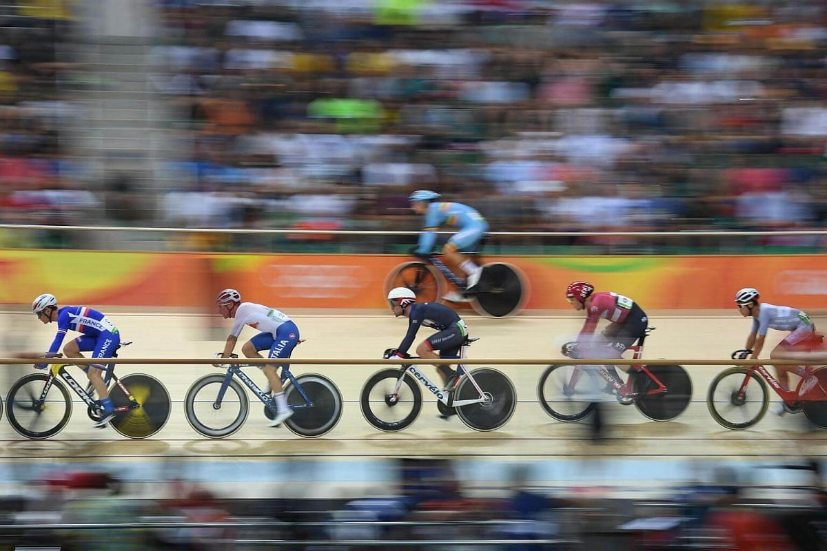 Britain's Mark Cavendish (centre) and Denmark's Lasse Norman Hansen (second from the right) compete in the men's omnium scratch race track cycling event on Aug 14.