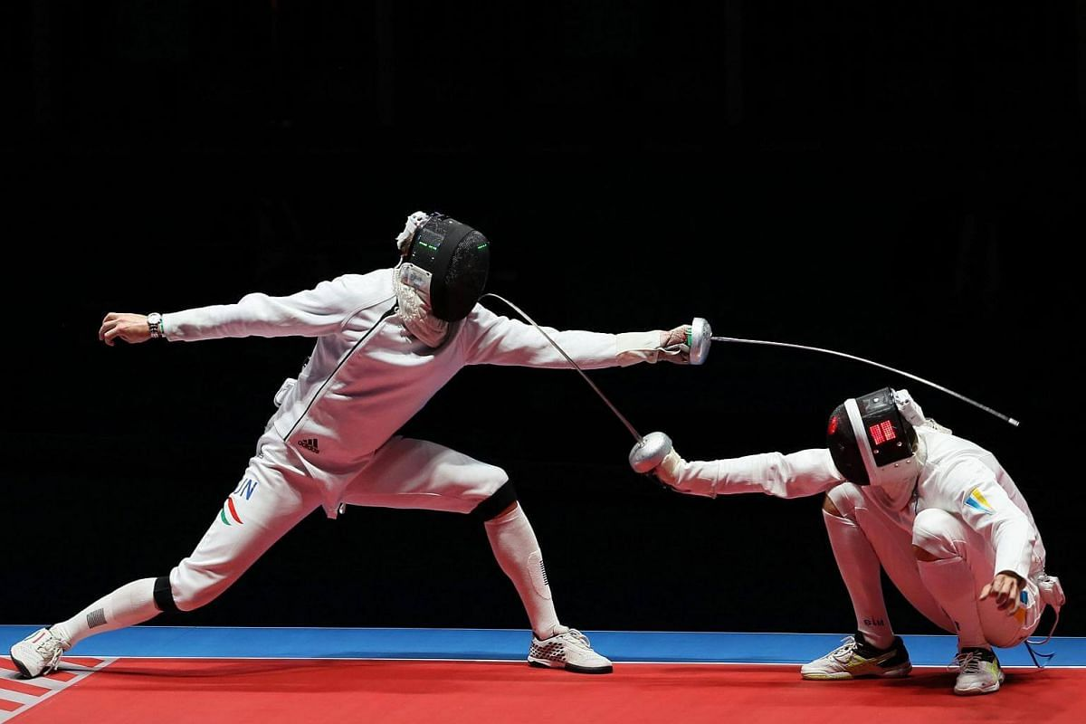 Geza Imre (left) of Hungary in action against Anatolii Herey (right) of Ukraine during the men's epee team bronze medal match of the Rio 2016 Olympic Games Fencing events on Aug 14.