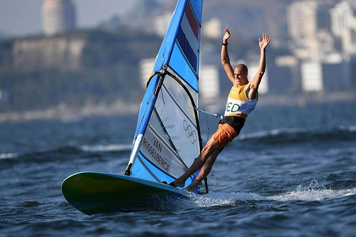 Netherlands' Dorian Van Rijsselberghe celebrates after winning the RS:X Men sailing final race on Guanabara Bay during the Rio 2016 Olympic Games on Aug 14.