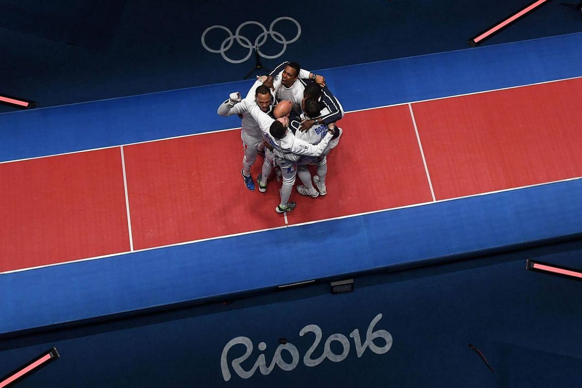 France's team celebrating after winning the men's team epee gold medal bout between Italy and France at the Rio 2016 Olympic Games on Aug 14.