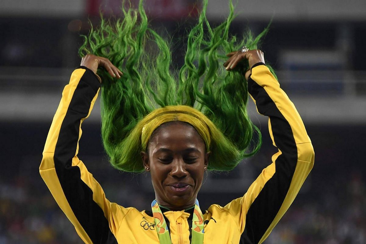 Bronze medallist Jamaica's Shelly-Ann Fraser-Pryce fixes her hair on the podium for the women's 100m final at the Rio 2016 Olympic Games on Aug 14.