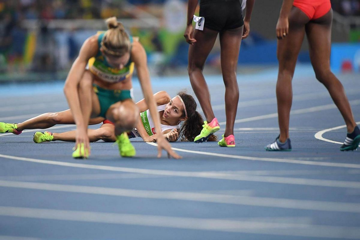 Poland's Sofia Ennaoui falls after competing in the women's 1500m semi-final during the athletics event at the Rio 2016 Olympic Games on Aug 14.