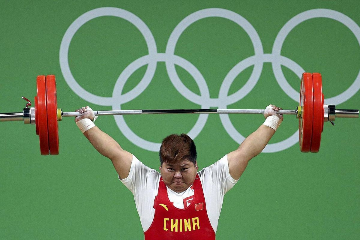 Meng Suping of China competing in the women's weightlifting final on Aug 14.