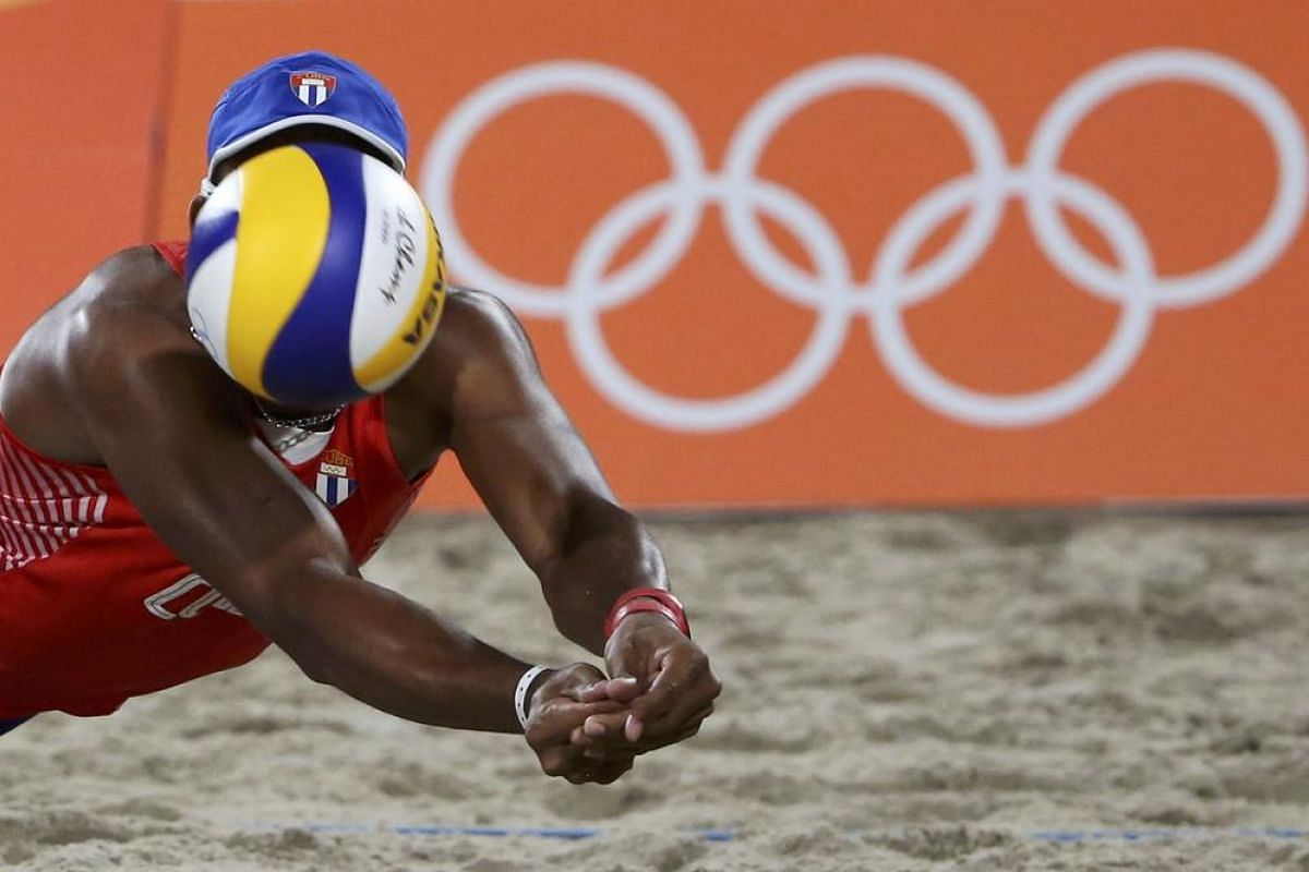 Sergio Gonzalez of Cuba competes in the beach volleyball men's quarterfinal.