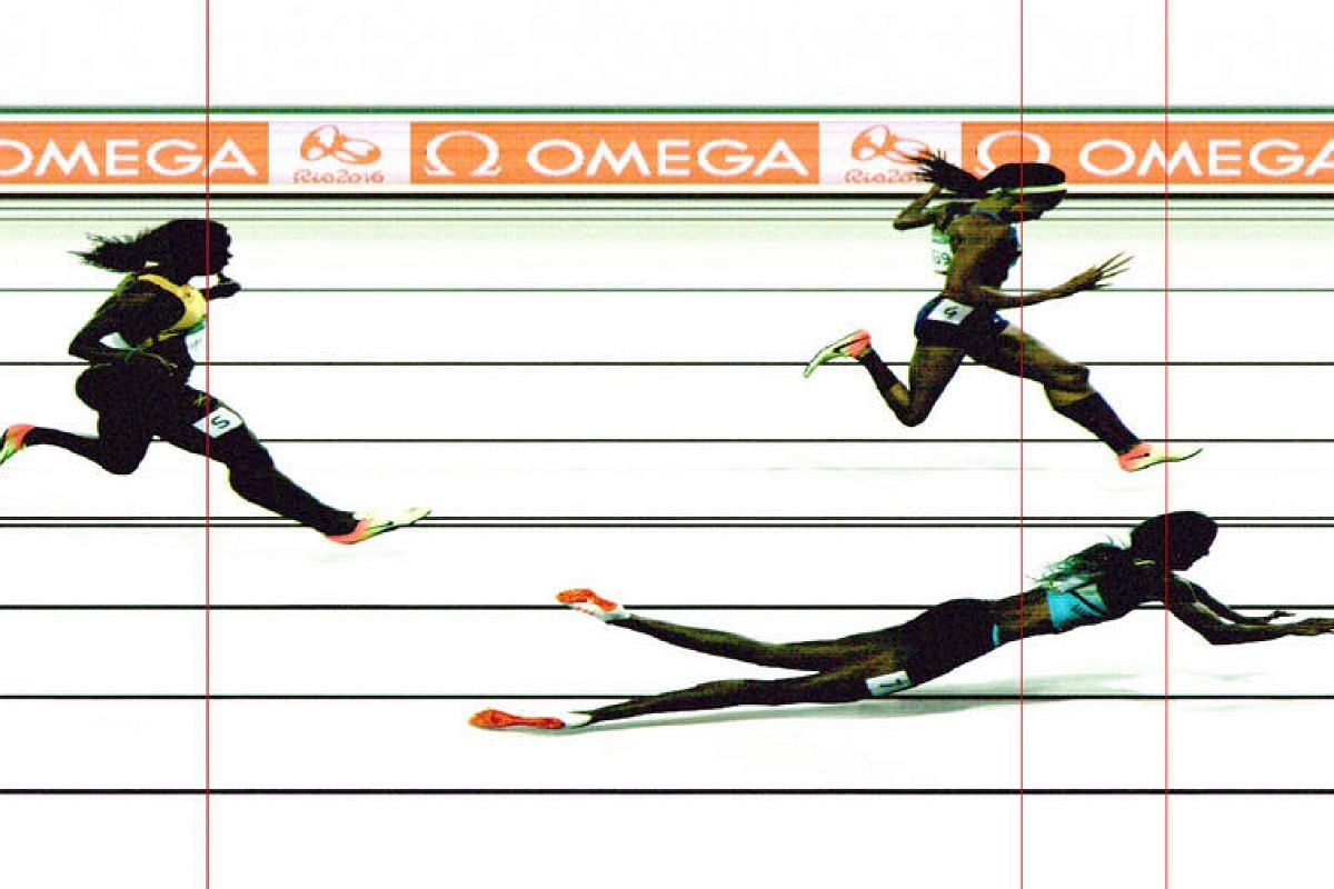 A handout photo released by Omega shows Bahamas's Shaunae Miller (front) crossing the finish line ahead of silver medallist US's Allyson Felix and bronze medalist Jamaica's Shericka Jackson (left) to win the Women's 400m Final.