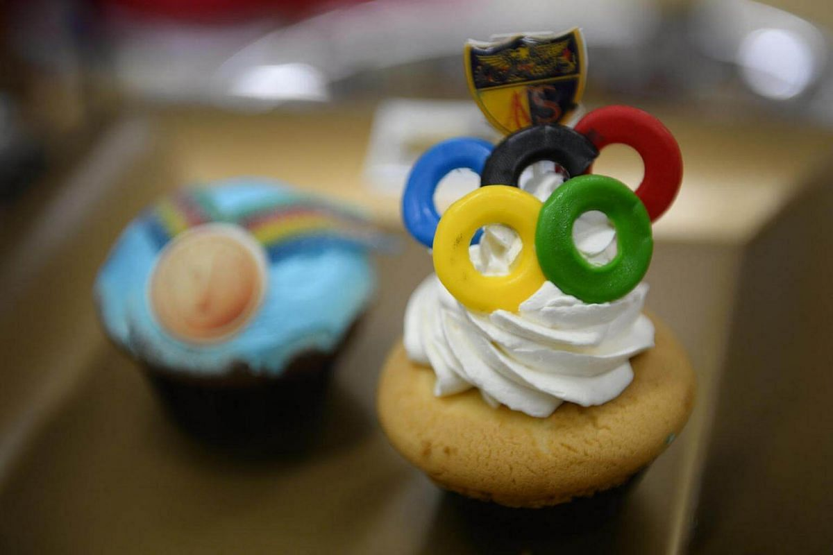 A cupcake topped with the Olympic rings and the Anglo-Chinese School crest pictured in the media room during a visit at ACS Junior on August 15.
